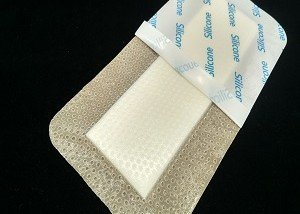 Soft silicone dressings